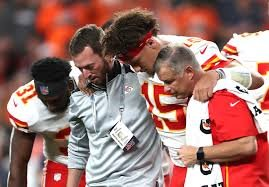 Patrick Mahomes is helped off the field after suffering a dislocated kneecap