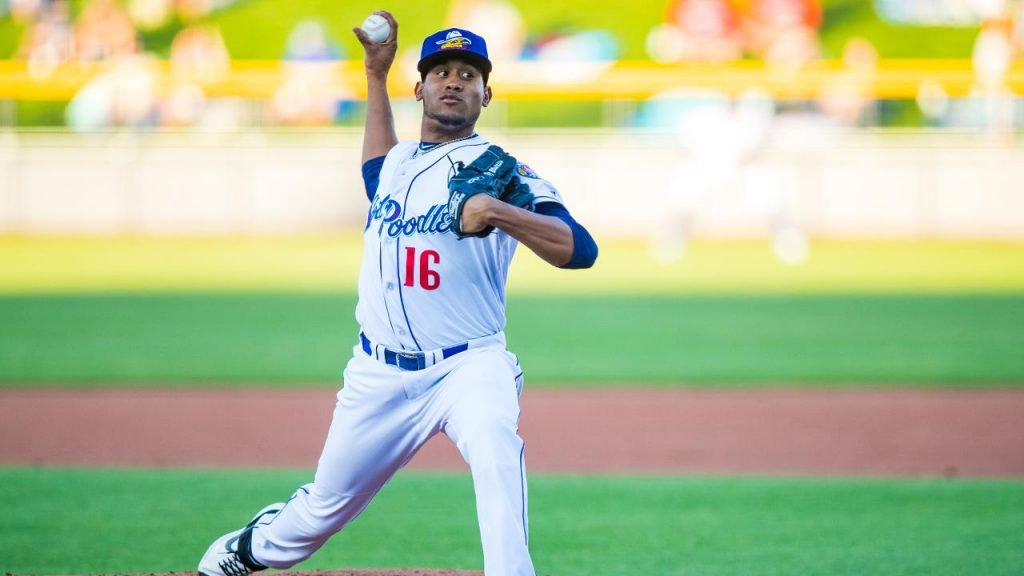 Ronald Bolanos pitching during a game.