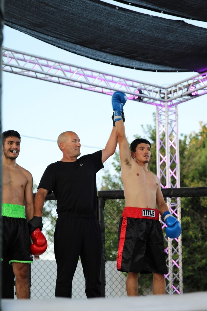 Tomas Ornelas getting his hand raised. Photo credit Ashlee Moreno.