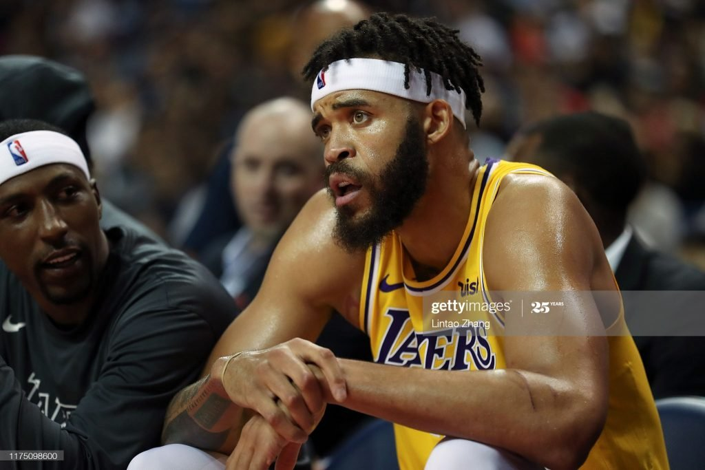 JaVale McGee watches during a preseason game.