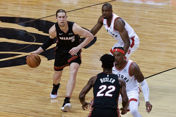 Kelly Olynyk of the Miami Heat looks to dish to Jimmy Butler