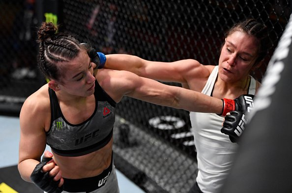 Alexa Grasso landing a punch on Maycee Barber. UFC 258 medical suspensions