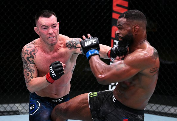 Colby Covington punching Tyron Woodley.