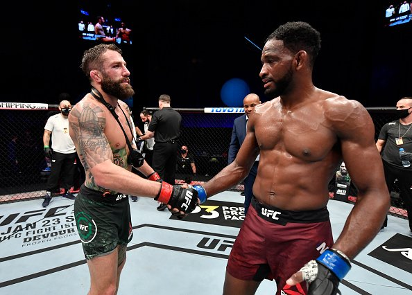 Michael Chiesa and Neil Magny shaking hands