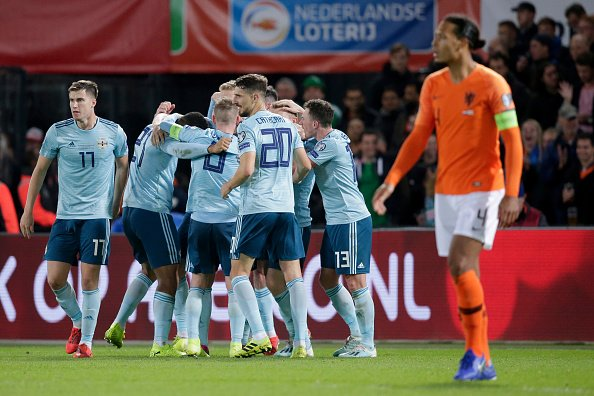 The Northern Ireland squad celebrating a goal in their EURO Qualifier match vs the Netherlands.