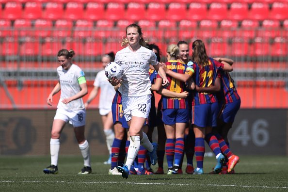Barcelona Femení celebrate scoring against Manchester City LFC in the Women's Champions League.