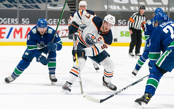 Image for Breaking News: Connor McDavid Becomes Ninth NHL Player to Reach 100 Points in 53 Games