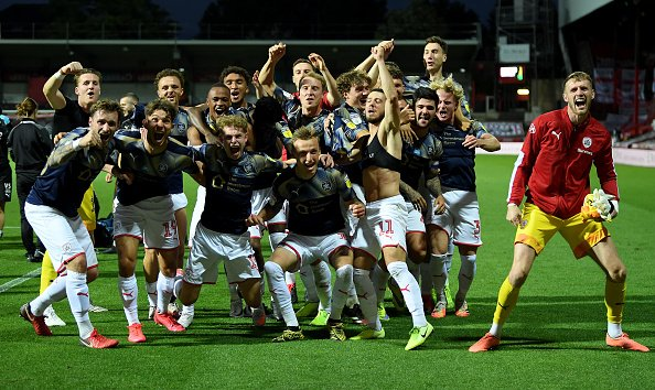 Barnsley celebrate their survival in the Championship after winning their final game of the 19/20 season.