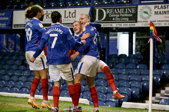 Portsmouth players pictured celebrating after going ahead against league high fliers Peterborough in League one.